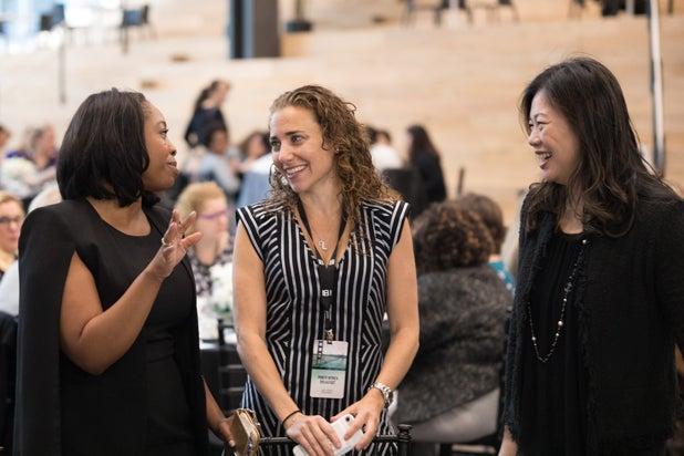 Kendra Bracken-Ferguson, Lisa Sugar and attendee at Silent auction at TheWrap's Power Women's Breakfast in San Francisco, 2017