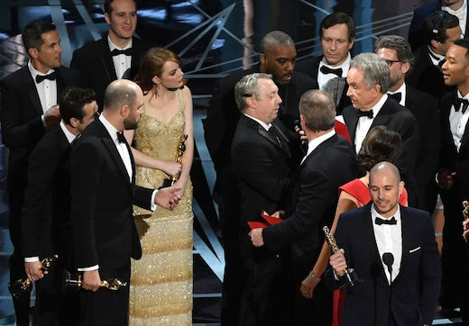 HOLLYWOOD, CA - FEBRUARY 26: 'La La Land' producer Fred Berger (R) speaks at the microphone as production staff consult behind him regarding a presentation error of the Best Picture award (later awarded to 'Moonlight') onstage during the 89th Annual Academy Awards at Hollywood & Highland Center on February 26, 2017 in Hollywood, California. (Photo by Kevin Winter/Getty Images)