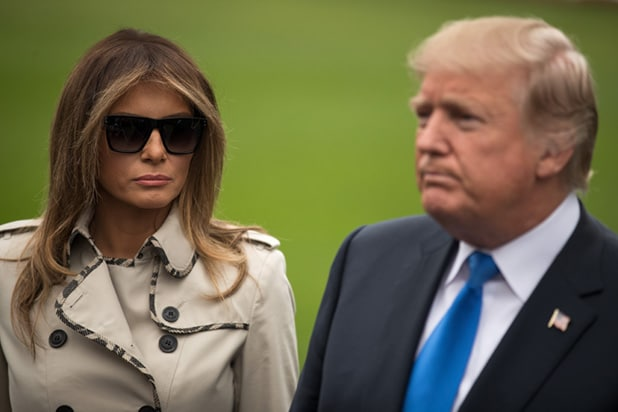 Image result for Does Melania Trump whisper sweet somethings?