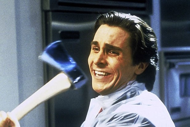 Christian Bale as Patrick Bateman in American Psycho. Bateman grins gleefully as he wields an axe in an iconic still from the film.