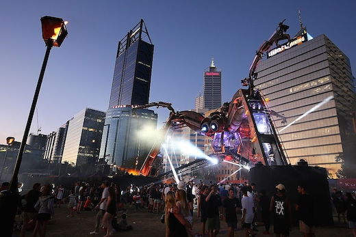 PERTH, AUSTRALIA - NOVEMBER 27: People dance to the music around the Arcadia Spider at Elizabeth Quay on November 25, 2016 in Perth, Australia. The Arcadia spider is made out of recycled military and industrial machinery and is over 15 metres tall. Arcadia Australia is exclusive to Perth, with events and shows taking place November 25 - 27. (Photo by Paul Kane/Getty Images)