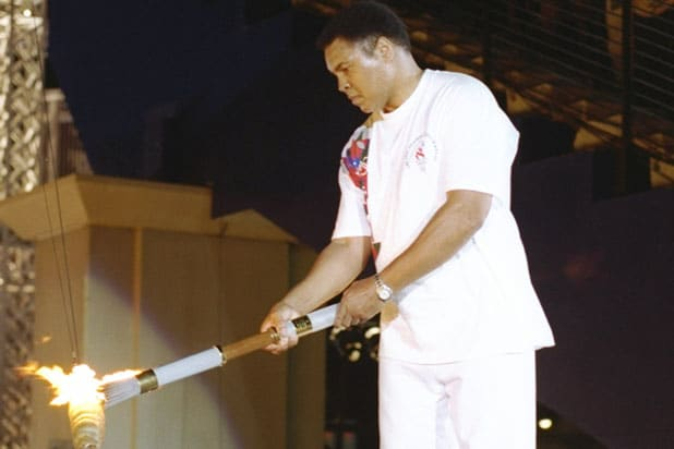 19 Jul 1996: Muhammad Ali holds the torch before lighting the Olympic Flame during the Opening Cere