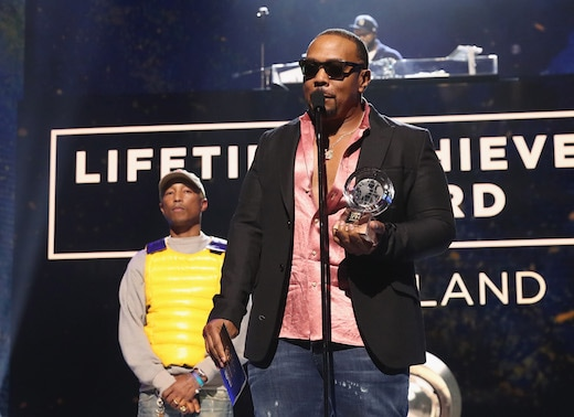 LOS ANGELES, CA - FEBRUARY 22: Pharrell Williams (L) presents award to Timbaland on stage at the 2018 Global Spin Awards at The Novo