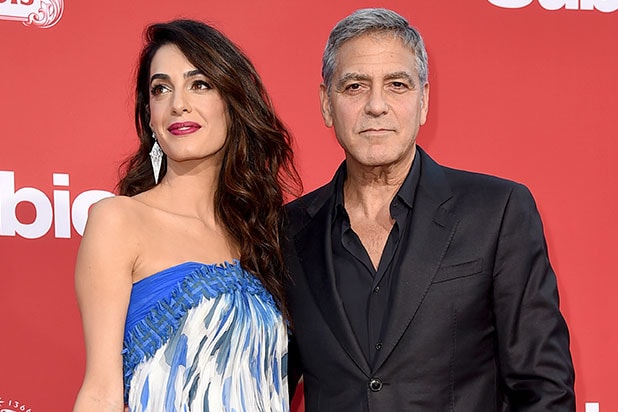 George, Amal Clooney donate $500000 to march against guns