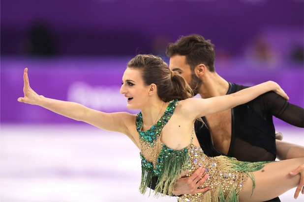 French Skater's Breast Pops Out During Mid-Routine Olympic Wardrobe Malfunction (Video)