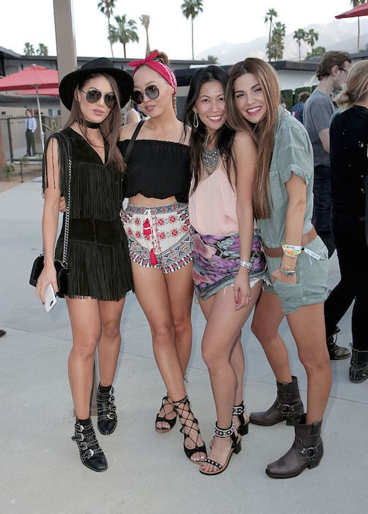 PALM SPRINGS, CA - APRIL 15: (L-R)Camilla Coelho, Dani Song, Raissa Gerona, and guest attend Moet & Chandon kicks off Coachella With REVOLVE on April 15, 2016 in Palm Springs, California. (Photo by Ari Perilstein/Getty Images for Moet & Chandon)