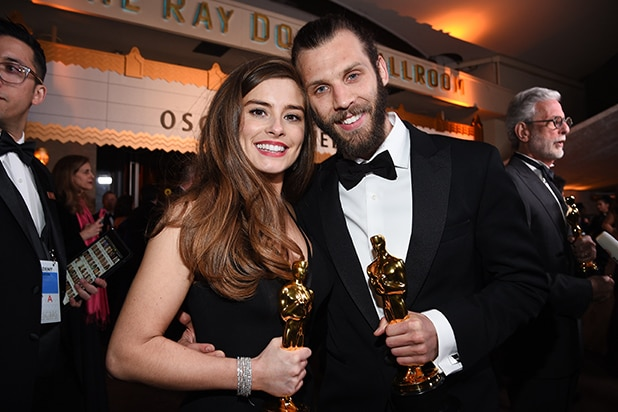 Rachel Shenton (R) and Chris Overton pose with awards for Best Live Action Short Film 'The Silent Child'