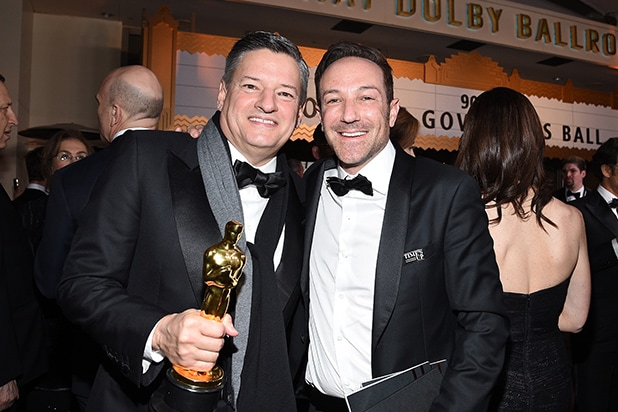 Netflix Chief Content Officer Ted Sarandos (L) and director Bryan Fogel, winner of the Best Documentary Feature award for 'Icarus,'