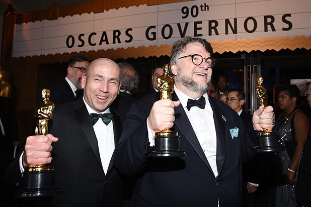 Guillermo del Toro (R), winner of the Best Director and Best Picture awards for 'The Shape of Water,' and producer J. Miles Dale
