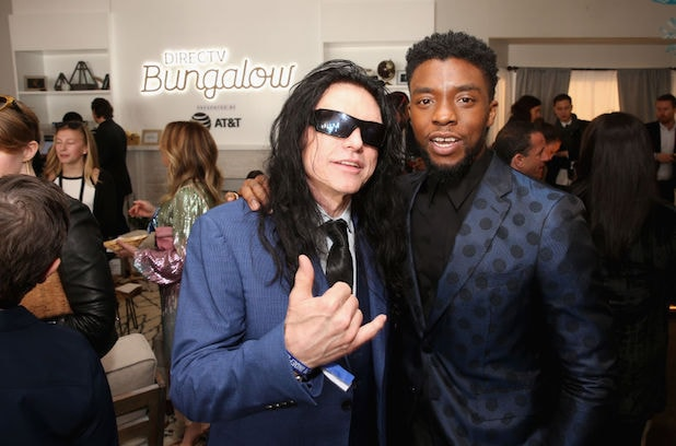 Tommy Wiseau (L) and Chadwick Boseman pose at the DIRECTV BUNGALOW presented by AT&T at the 2018 Film Independent Spirit Awards on March 3,