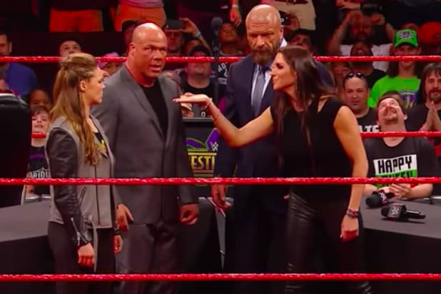 1259ed5b3e4d2 Watch Stephanie McMahon Slam Ronda Rousey Through a Table (Video)