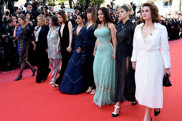 Sofia Boutella Salma Hayek Patty Jenkins Claudia Cardinale and other filmaker walk on the red carpet in protest of the lack of female filmmakers honored throughout the history of the festival at the screening of 'Girls Of The Sun (Les Filles Du So