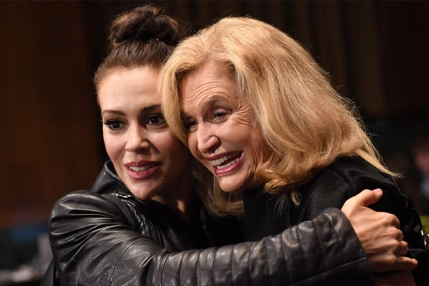 Actress Alyssa Milano, left, hugs Rep. Carolyn Maloney, D-N.Y., in the hearing room before the start of Dr. Christine Blasey Ford's appearance in the Senate Judiciary Committee to testify on the nomination of Brett M. Kavanaugh to be an associate justice of the Supreme Court of the United States