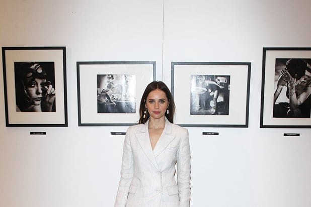 Felicity Jones poses in front of Georgina Cates photography
