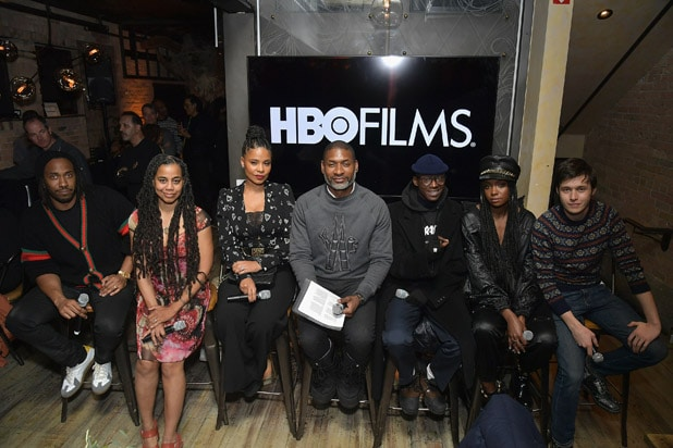 "PARK CITY, UT - JANUARY 26: Rashid Johnson, Suzan Lori-Parks, Sanaa Lathan, Ashton Sanders, Kiki Layne, and Nick Robinson attend the HBO Film ""Native Son"" Dinner At Sundance 2019 at Tupelo on January 26, 2019 in Park City, Utah. (Photo by Michael Loccisano/Getty Images for HBO)"