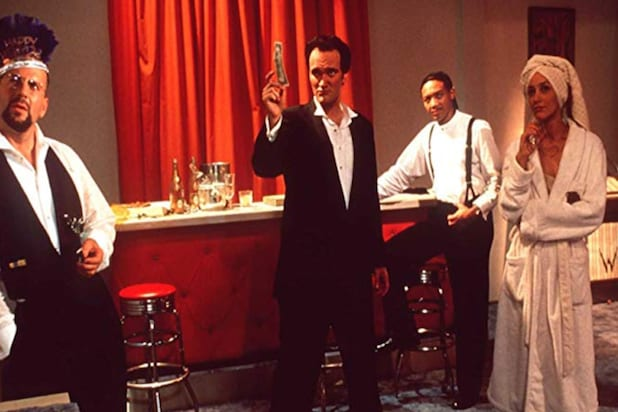 "Still of Quentin Tarantino, Bruce Willis, Jennifer Beals and Paul Calderon in ""Four Rooms"""