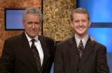 Jeopardy host Alex Trebek, (L) poses contestant Ken Jennings after his earnings from his record breaking streak on the gameshow surpassed 1 million dollars July 14, 2004 in Culver City, California