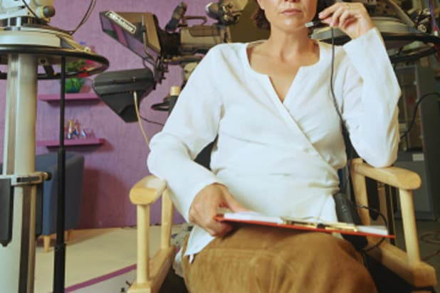 Woman in chair on television set