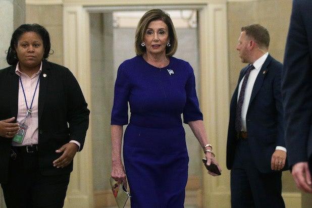 Nancy Pelosi leaving her office