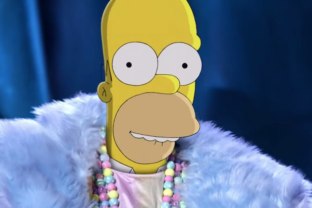 Watch Homer Simpson Cross Over Onto The Masked Singer In