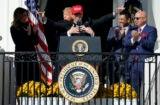 Washington Nationals catcher Kurt Suzuki hugged by Donald Trump