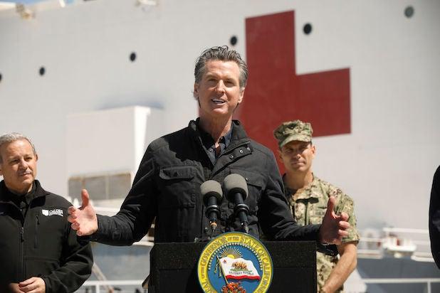 Gavin Newsom speaks in front of the USNS Mercy
