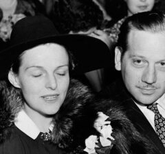 Melvyn Douglas sits with his wife actress Helen Gahagan Douglas