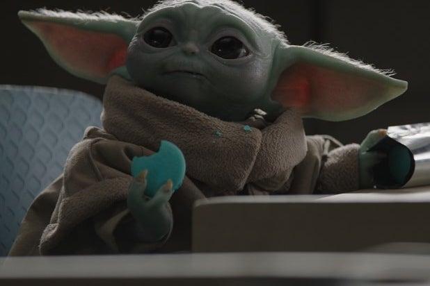 Baby Yoda eating macarons