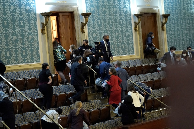 Members of Congress evacuate the House Chamber Capitol Building Riot