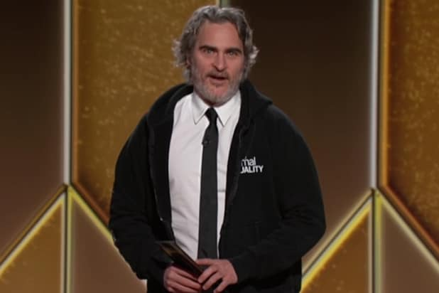 golden globes joaquin phoenix presents best actor wearing a hoodie