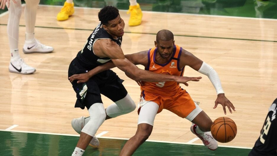 Giannis Antetokounmpo #34 of the Milwaukee Bucks Chris Paul #3