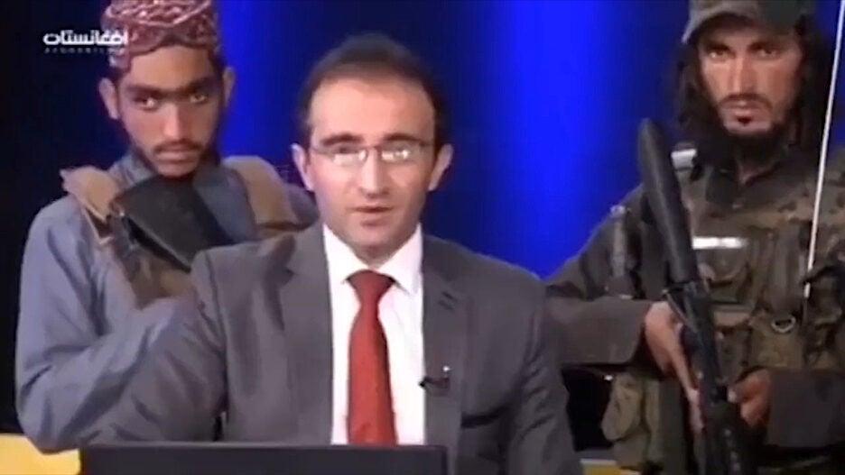 Taliban militants TV host