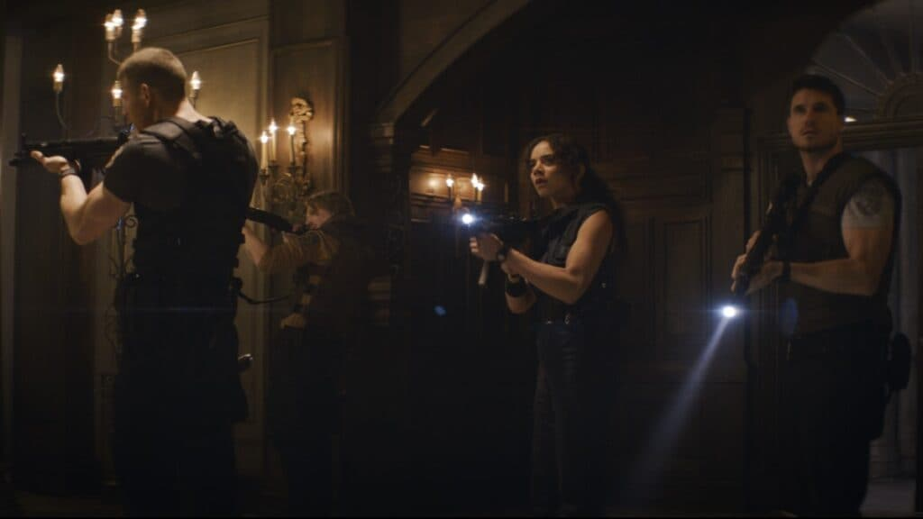 Albert Wesker (Tom Hopper), Richard Aiken (Chad Rook), Jill Valentine (Hannah John-Kamen), and Chris Redfield (Robbie Amell)